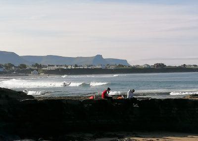 Students and Surfer at Main Beach